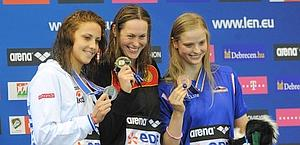 23-year-old Arianna Barbieri on the podium of the 100 metres backstroke. Afp